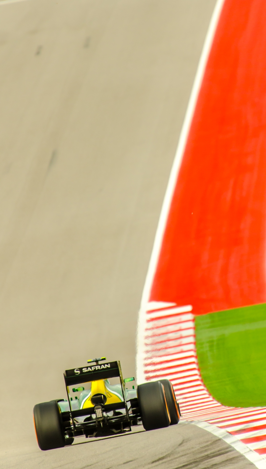 The Caterham CT03 exiting Turn 12 at the 2013 USGP held at the Circuit of the Americas.